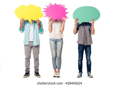 Full length portrait of young people in casual clothes hiding behind speech bubbles, isolated on white background