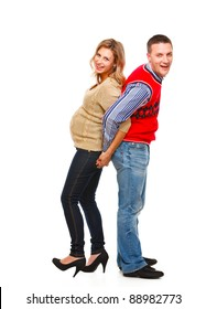 Full length portrait of young pregnant with husband having fun on white background