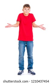 Full length portrait of young teen boy - I don't know, isolated on white background. Funny surprised teenager being at loss throwing up hands. Handsome confused child showing helpless gesture with arm