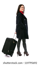 Full length portrait of a young woman holding a luggage isolated on white background