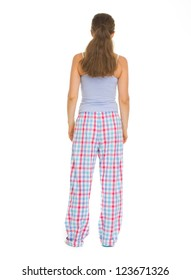 Full length portrait of young woman in pajamass. Rear view