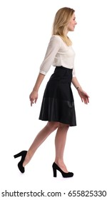 Full length portrait of a young woman walking on white background