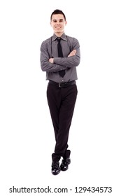 Full length pose of successful young businessman, isolated on white background, arms and legs crossed
