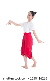 Full length of pretty Thai girl with traditional Thai student dress showing Thai style dance isolated over white background.