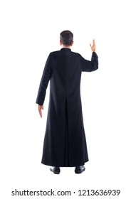 Full length priest blessing arm rear view of back soutane