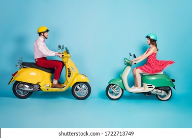 Full length profile photo of funny lady guy couple drive retro moped travelers opposite missed each other good mood glad meeting vintage outfit protective caps isolated blue color background