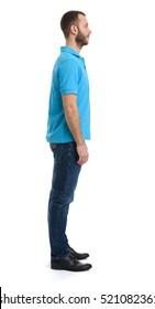 full length profile portrait of bearded dude standing on white background