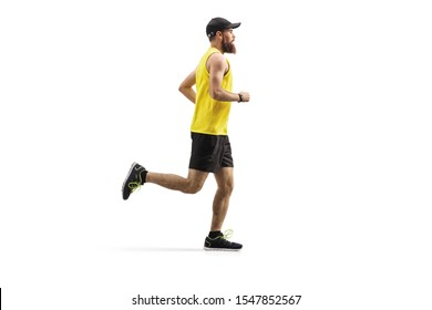 Full length profile shot of a bearded man with a cap running isolated on white background