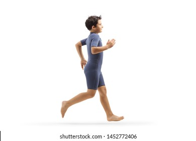 Full length profile shot of a boy in a wetsuit running isolated on white background