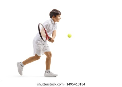 Full length profile shot of a boy playing tennis isolated on white background