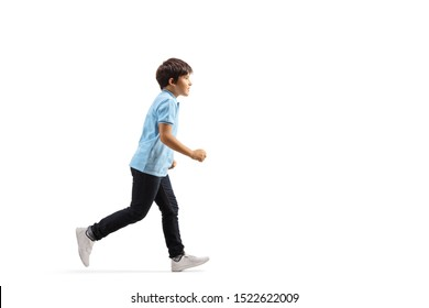 Full length profile shot of a boy in jeans running isolated on white background