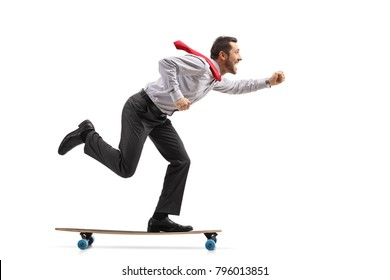 Full length profile shot of a businessman riding a longboard isolated on white background
