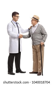 Full length profile shot of a doctor and a mature man shaking hands isolated on white background