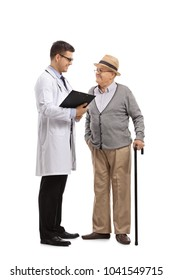 Full length profile shot of a doctor talking to an elderly patient isolated on white background