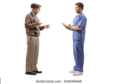 Full length profile shot of a doctor and mature patient having a conversation isolated on white background