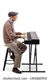 Full length profile shot of an elderly man playing a digital piano isolated on white background