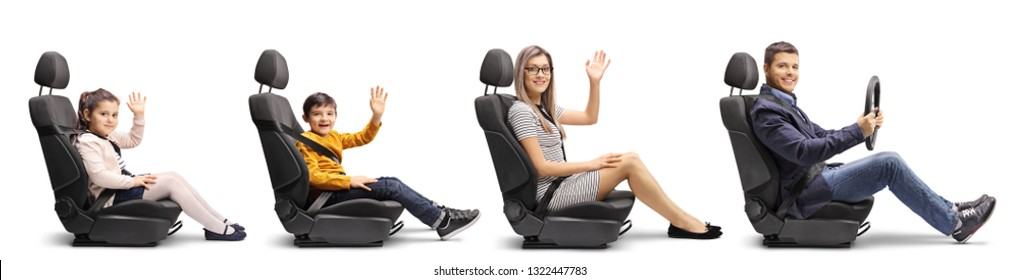 Full length profile shot of a family of a mother, son and daughter in car seats waving and a father holding a steering wheel with seat belts on isolated on white background