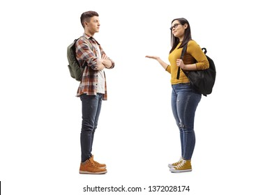 Full length profile shot of female student talking to a male student friend isolated on white background