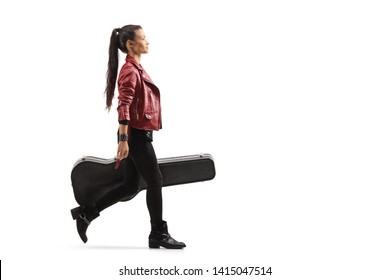 Full length profile shot of a female musician walking and carrying a guitar in a case isolated on white background