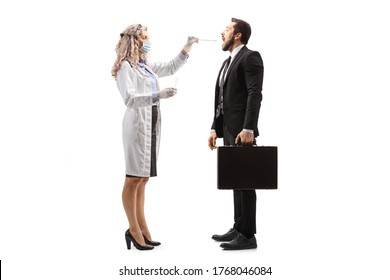 Full length profile shot of a female doctor with a medical mask doing a cotton swab test to a businessman isolated on white background