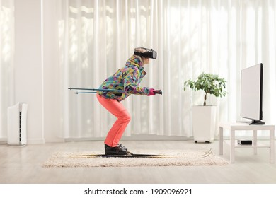 Full length profile shot of a female with a vr headset skiing at home