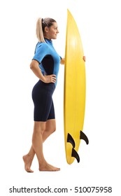 Full length profile shot of a female surfer with a surfboard isolated on white background
