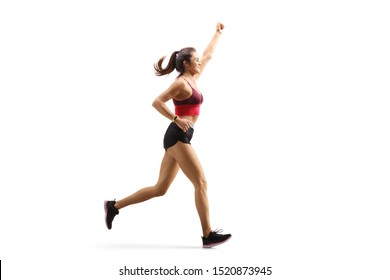 Full length profile shot of a fit young woman in sportswear running and gesturing with hand isolated on white background