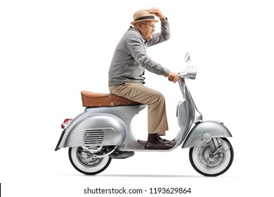 Full length profile shot of a gentleman riding a vintage motorbike isolated on white background