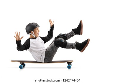 Full length profile shot of a happy boy with helmet sitting on a longboard and riding isolated on white background