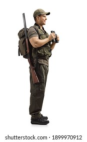 Full length profile shot of a hunter with a rifle in a uniform holding binoculars isolated on white background