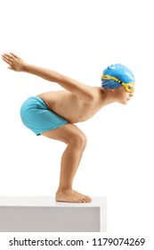 Full length profile shot of a little boy swimmer ready to jump isolated on white background