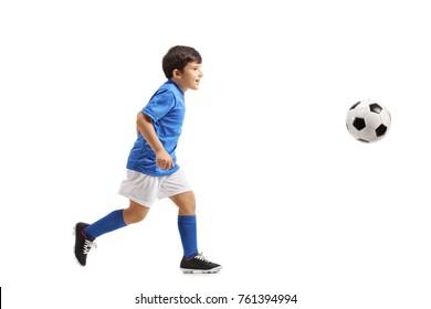 Full length profile shot of a little footballer running isolated on white background