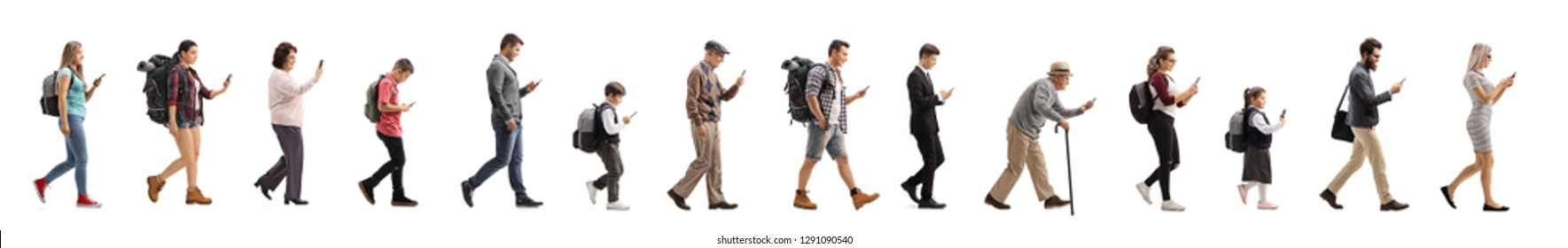 Full length profile shot of a long queue of people walking and using a mobile phone isolated on white background