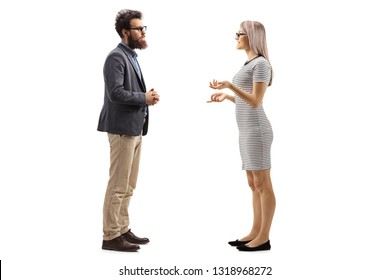 Full length profile shot of a man and woman standing and talking isolated on white background