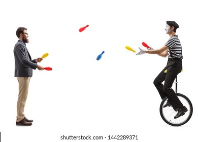 Full length profile shot of a mime on a unicycle juggling with a man isolated on white background