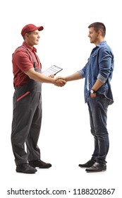 Full length profile shot of a mover shaking hands with a young man isolated on white background