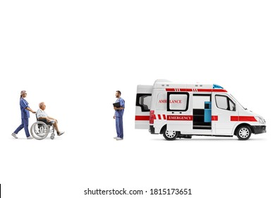 Full length profile shot of a nurse pushing an elderly patient in a wheelchair towards an ambulance isolated on white background