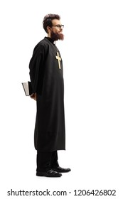 Full length profile shot of a priest with a bible waiting in line isolated on white background