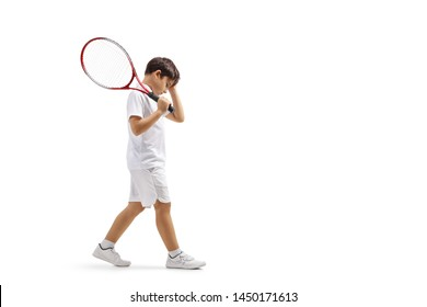 Full length profile shot of a sad boy with a tennis racquet isolated on white background