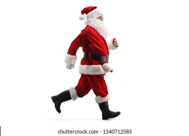 Full length profile shot of Santa Claus running fast isolated on white background