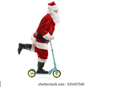 Full length profile shot of santa claus riding a scooter isolated on white background