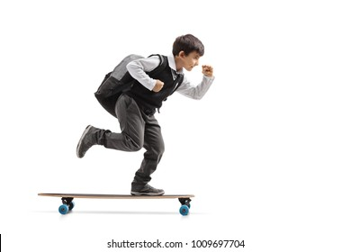Full length profile shot of a schoolboy riding a longboard isolated on white background