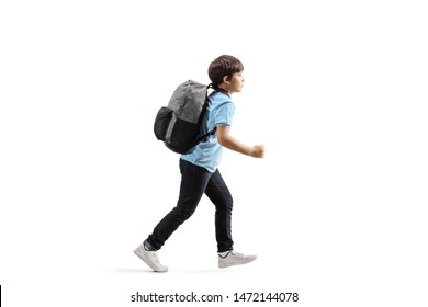 Full length profile shot of a schoolboy with a backpack running isolated on white background