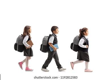 Full length profile shot of schoolchildren walking isolated on white background
