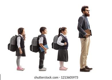 Full length profile shot of schoolchildren waiting in line behing male teacher isolated on white background