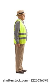 Full length profile shot of a senior man with a safety vest standing isolated on white background
