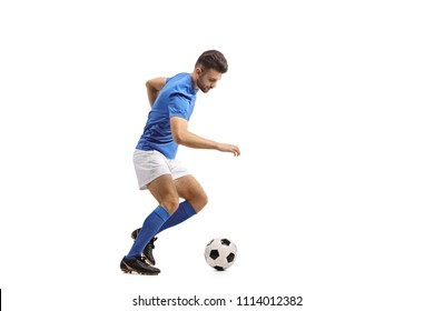 Full length profile shot of a soccer player dribbling isolated on white background