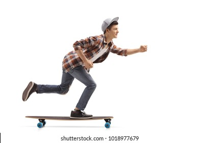 Full length profile shot of a teen hipster riding a longboard isolated on white background