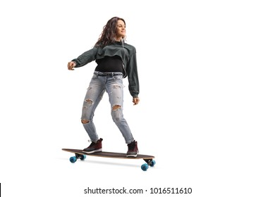 Full length profile shot of a teenage girl riding a longboard isolated on white background