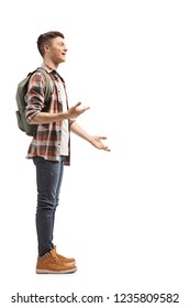 Full length profile shot of a teenage student standing and talking isolated on white background